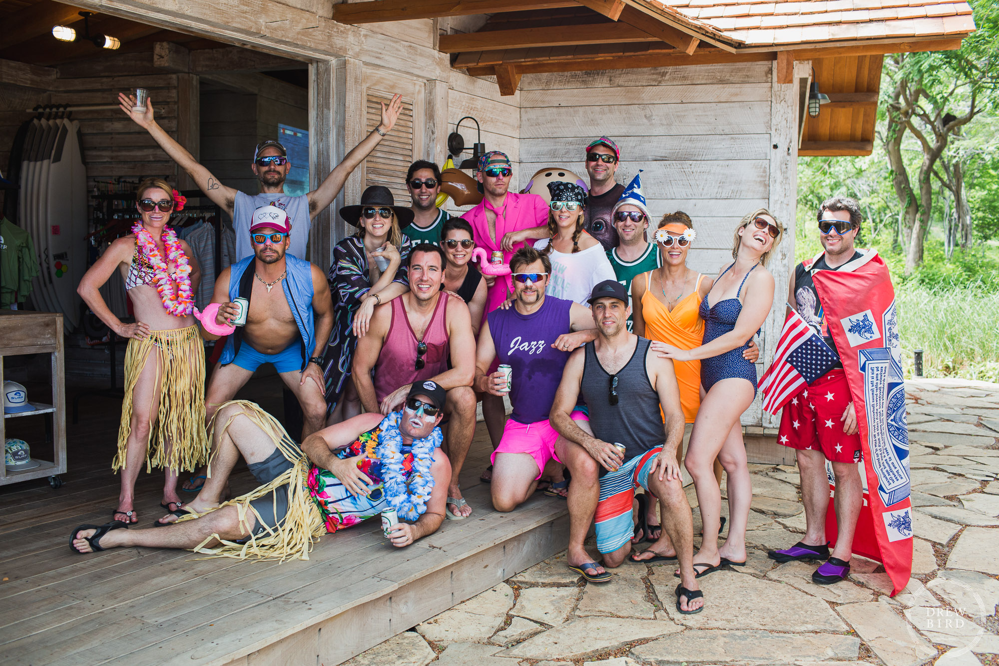 Group of people in costume for a theme beach at playa los perros. Beach welcome party. Rancho Santana Nicaragua destination wedding photographer Drew Bird.