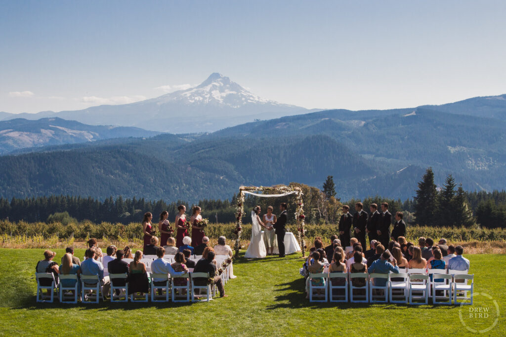 Jewish wedding ceremony. Bride and groom under chuppah with Mt Hood in the distance. Gorge Crest Vineyard wedding near Hood River, Oregon. San Francisco wedding photojournalist Drew Bird Photo.