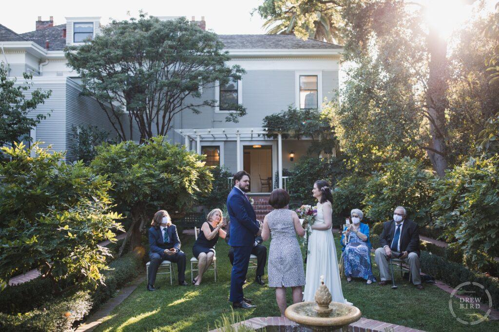 Elopement wedding ceremony in the garden at Gamble Gardens. Palo Alto and San Francisco micro wedding photographer Drew Bird.