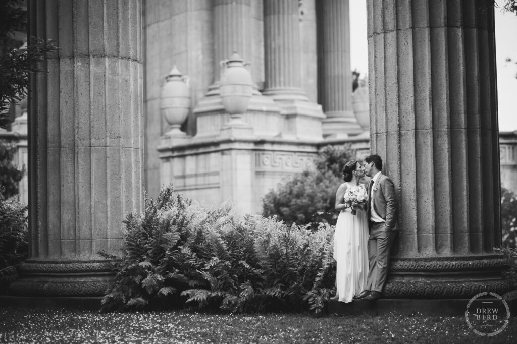 Bride and groom kissing black and white photo. Palace of Fine Arts wedding. San Francisco photographer Drew Bird.