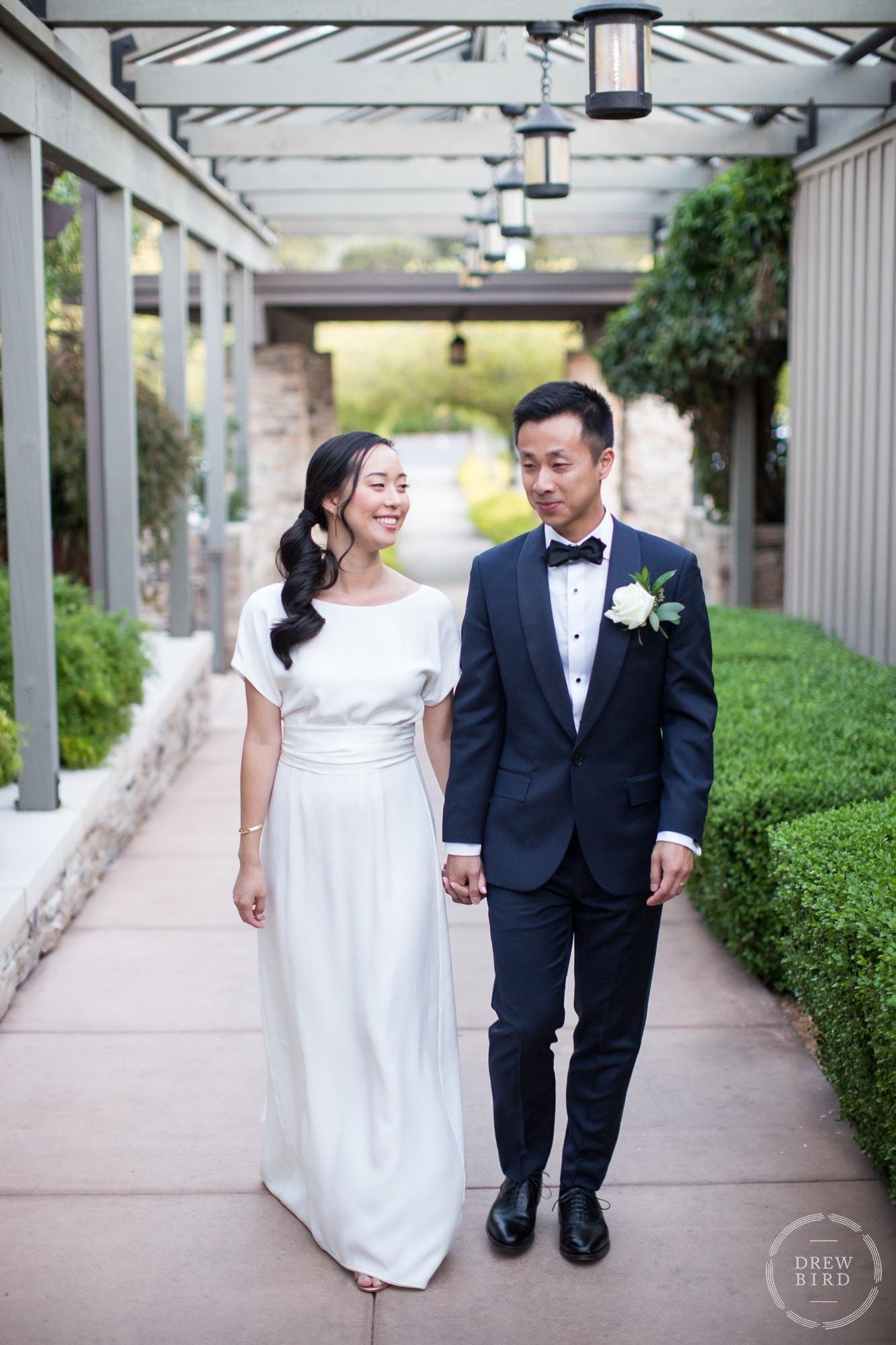Bride and groom walking together. Quail Meadows wedding. Quail Lodge and Golf Club wedding. Carmel wedding photographer. Monterrey wedding photographer Drew Bird.