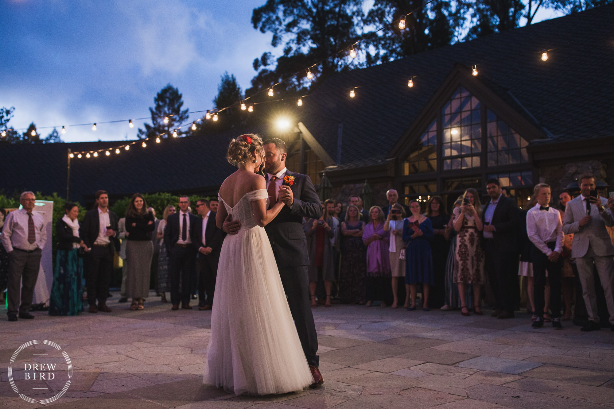 Bride and groom first dance photo on the outdoor patio at sunset for Brazilian Room wedding in Tilden Park Berkeley California.